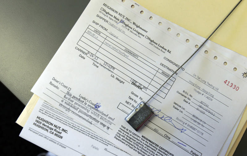 In this Tuesday, Sept. 24, 2013 photo, a number seal sits on the paperwork to go with a truckload of almonds at Hughson Nut, Inc., in Livingston, Calif. Hughson has joined a growing number of companies that have become victims of an increasingly common form of commercial identity theft that has allowed con men to make off each year with millions of dollars in merchandise. Thieves, posing as truckers, load freight onto their own tractor-trailers and drive away. (AP Photo/Rich Pedroncelli)