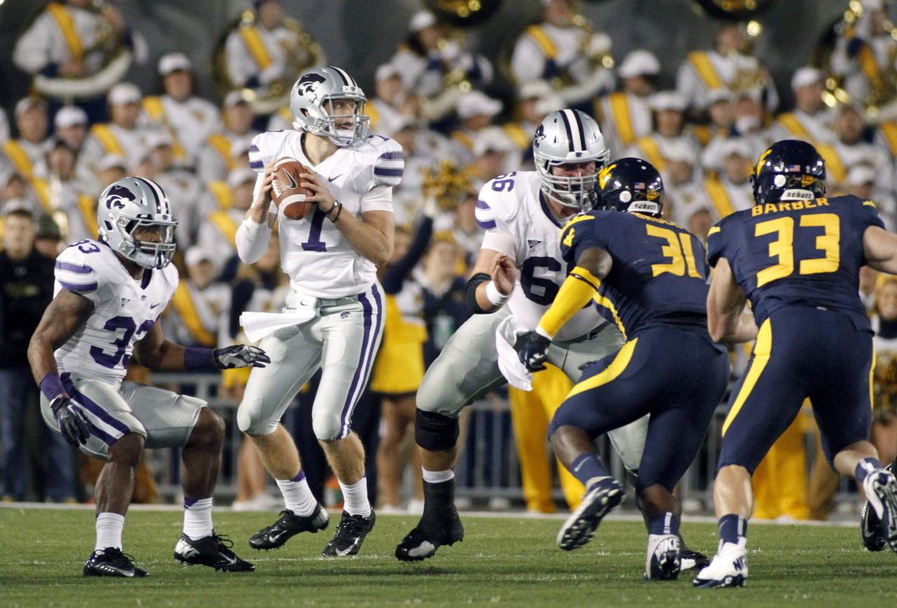 MORGANTOWN, WV - OCTOBER 20:  Collin Klein #7 of the Kansas State Wildcats drops back to pass against the West Virginia Mountaineers during the game on October 20, 2012 at Mountaineer Field in Morgantown, West Virginia.  (Photo by Justin K. Aller/Getty Images)