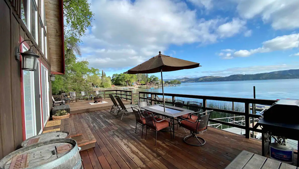 """<h2>Clear Lake, CA</h2><br><strong>Location</strong>: Lower Lake, CA<br><strong>Sleeps</strong>: 8<br><strong>Price Per Night</strong>: <a href=""""https://airbnb.pvxt.net/doOb9M"""" rel=""""nofollow noopener"""" target=""""_blank"""" data-ylk=""""slk:$236"""" class=""""link rapid-noclick-resp"""">$236</a><br><br>""""This lakefront cabin with updated decor is fully stocked with all amenities including a washer and dryer. If you are looking for romance, relaxing time with family, or a fishing location, this cabin is the perfect place! Large deck space provides plenty of room to enjoy the panoramic picturesque views while enjoying your dinner outside if you wish. You can enjoy all that Clear Lake offers including world-class fishing, water sports, or take a tour of local wineries without the crowds of Napa.""""<br><br><h3>Book <a href=""""https://airbnb.pvxt.net/doOb9M"""" rel=""""nofollow noopener"""" target=""""_blank"""" data-ylk=""""slk:Beautiful Lakefront Cabin on Clear Lake"""" class=""""link rapid-noclick-resp"""">Beautiful Lakefront Cabin on Clear Lake</a></h3><br>"""