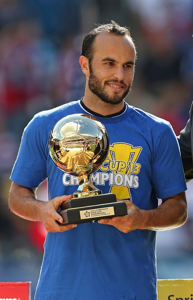 CHICAGO, IL - JULY 28: Landon Donovan #10 of the United States holds the Most Valuable Player trophy after a win over Panama during the CONCACAF Gold Cup final match at Soldier Field on July 28, 2013 in Chicago, Illinois. The United States defeated Panama 1-0. (Photo by Jonathan Daniel/Getty Images)