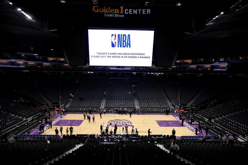 Sacramento's arena empties out after the NBA game between the New Orleans Pelicans and Sacramento Kings was postponed at the last minute in California on Wednesday. The NBA suspended its season indefinitely.