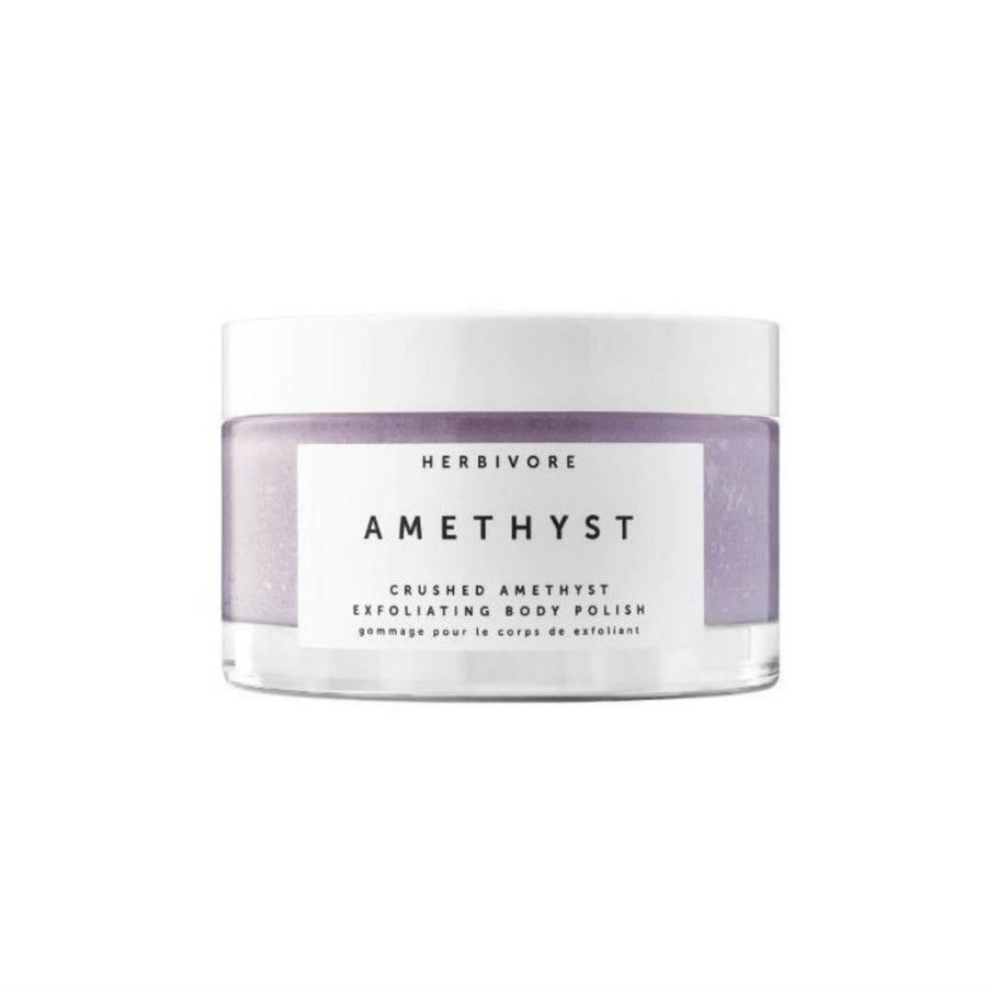 """<p>Just this once, we give you permission to judge a product by its packaging. The Instagram-ready Herbivore Crushed Amethyst Exfoliating Body Polish happens to be as effective as it is gorgeous. The pale lavender paste is brimming with Epsom salt and virgin coconut oil, as well as ground and tumbled amethyst gemstones for instantly boosting skin's luminosity and smoothness, making it an easy choice for a 2019 Best of Beauty Award.</p> <p><strong>$44 (<a href=""""https://shop-links.co/1683939728665653742"""" rel=""""nofollow"""">Shop Now</a>)</strong></p>"""