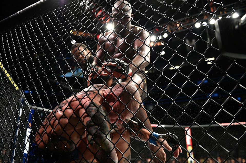 LAS VEGAS, NEVADA - MARCH 02:  (R-L) Jon Jones lands an illegal knee against Anthony Smith in their light heavyweight championship bout during the UFC 235 event at T-Mobile Arena on March 2, 2019 in Las Vegas, Nevada. (Photo by Chris Unger/Zuffa LLC/Zuffa LLC via Getty Images)