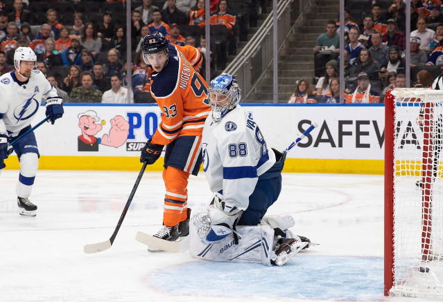 Edmonton Oilers center Ryan Nugent-Hopkins (93) watches as a teammate's shot goes past Tampa Bay Lightning goaltender Andrei Vasilevskiy for a goal during the second period of an NHL hockey game Saturday, Dec. 22, 2018, in Edmonton, Alberta. (Codie McLachlan/The Canadian Press via AP)