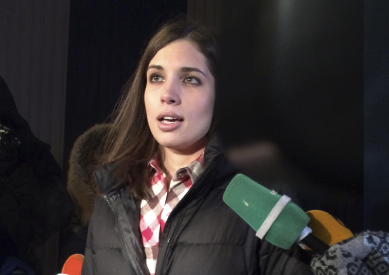 Nadezhda Tolokonnikova speaks to the media after leaving prison in Krasnoyarsk, Russia, Monday, Dec. 23, 2013. The third member of the Russian punk bank Pussy Riot has been released from custody following an amnesty law passed by parliament. Tolokonnikova left the prison colony in the eastern Siberian city of Krasnoyarsk on Monday, hours after another band member, Maria Alekhina, was released in another region. (AP Photo/Alexander Roslyakov)