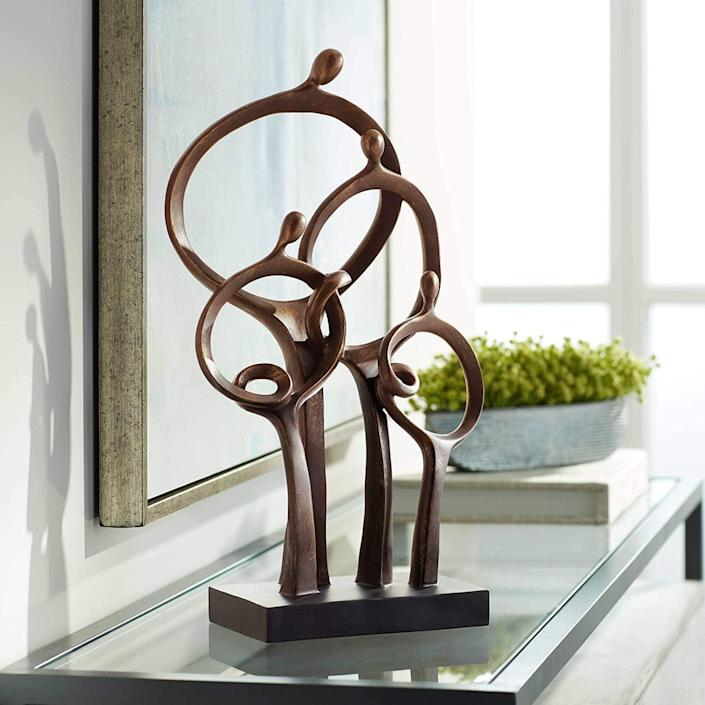 <p>This <span>Kensington Hill Abstract Family High Bronze Sculpture</span> ($90) makes a thoughtful addition to any surface.</p>