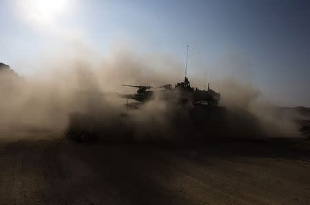 An Israeli army tank moves near the border with the Gaza Strip July 27, 2014. REUTERS/Ronen Zvulun