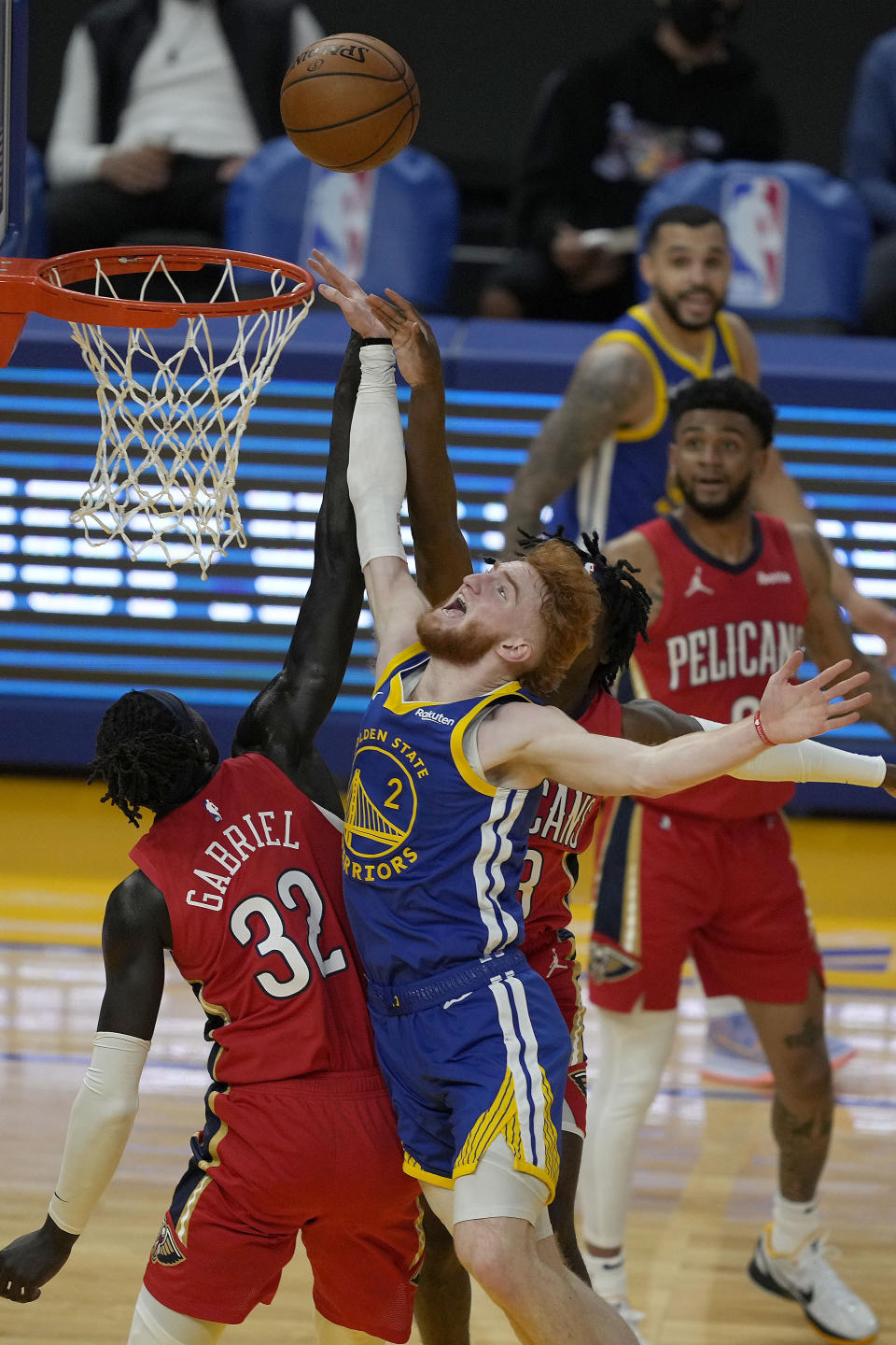 Golden State Warriors' Nico Mannion (2) reacts as he fouled by New Orleans Pelicans forward Wenyen Gabriel (32) during the first half of an NBA basketball game on Friday, May 14, 2021, in San Francisco. (AP Photo/Tony Avelar)