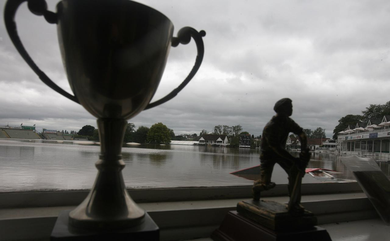 WORCESTER, UNITED KINGDOM - SEPTEMBER 07:  Trophies sit on a window sill as staff at Worcestershire County Cricket Club ground survey the damage caused by flooding on September 7, 2008 in Worcester, England. Heavy rain, as much as one months rainfall in 24 hours, has caused flash floods and flooding, leading to widespread disruption to many parts of the UK.  (Photo by Matt Cardy/Getty Images)