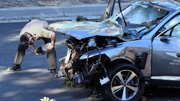PHOTO: Los Angeles County Sheriff's Deputies inspect the vehicle of golfer Tiger Woods after it was involved in a single-vehicle accident in Los Angeles, Feb. 23, 2021. (Gene Blevins/Reuters)