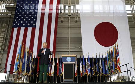 U.S. Defense Secretary Hagel speaks to U.S. and Japan military personnel stationed at Yokota Air Base on the outskirts of Tokyo