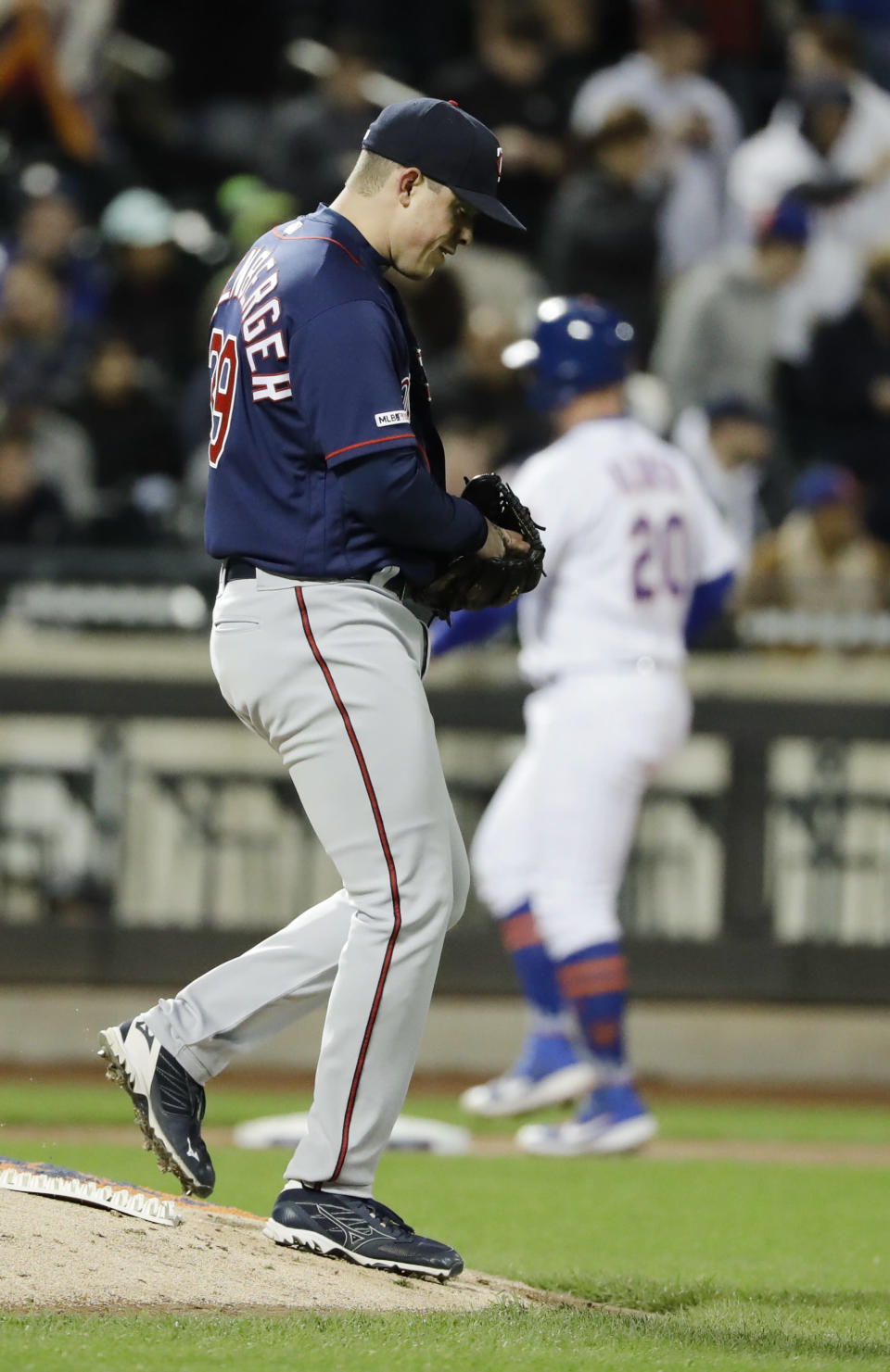 Minnesota Twins relief pitcher Trevor Hildenberger reacts after walking in a run during the fifth inning of the team's baseball game against the New York Mets on Wednesday, April 10, 2019, in New York. (AP Photo/Frank Franklin II)