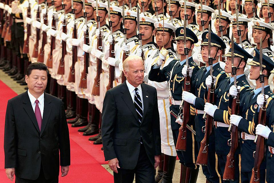 The then Chinese Vice President Xi Jinping with the then US Vice President Joe Biden during a meeting in 2011 in Beijing. Both men now hold their respective presidencies. Source: Getty