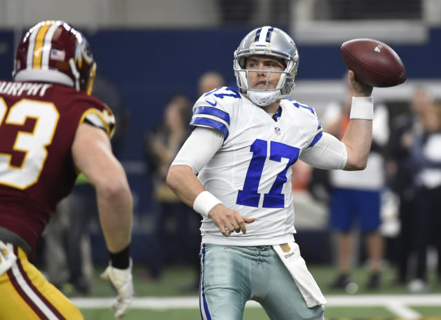 FILE - In this Jan. 3, 2016, file photo, Washington Redskins outside linebacker Trent Murphy (93) applies pressure as Dallas Cowboys quarterback Kellen Moore (17) during the first half of an NFL football game in Arlington, Texas. Two years ago, Moore went into training camp as the backup to Tony Romo before breaking an ankle in practice. Because of that injury, Prescott became the starter when Romo injured his back in a preseason game. (AP Photo/Michael Ainsworth, File)