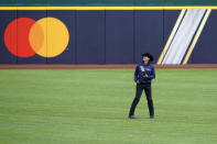 Tampa Bay Rays pitcher Brent Honeywell Jr. wears boots and a cowboy hat as he walks across the outfield at Globe Life Field as the team prepares for the baseball World Series against the Los Angeles Dodgers, in Arlington, Texas, Wednesday, Oct. 14, 2020. (AP Photo/Eric Gay)