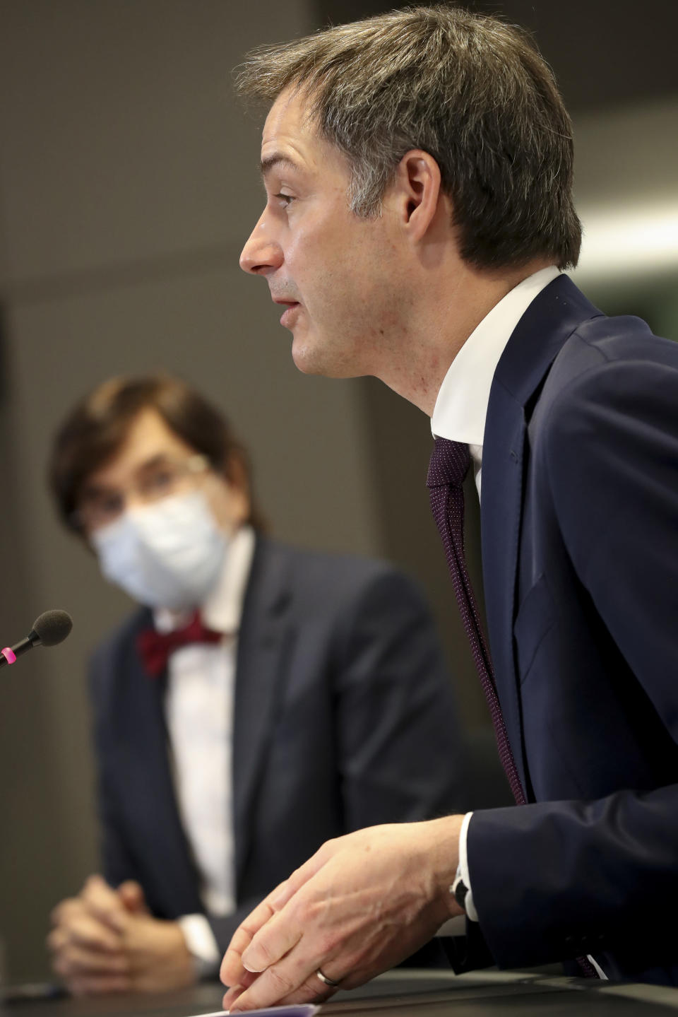 Belgium's Prime Minister Alexander De Croo, right, speaks during a media conference after a meeting of the consultative committee of government ministers in Brussels, Wednesday, March 24, 2021. Ministers met on Wednesday to discuss a possible tightening of COVID-19 measures as infections are once again on the rise. (Benoit Doppagne, Pool via AP)