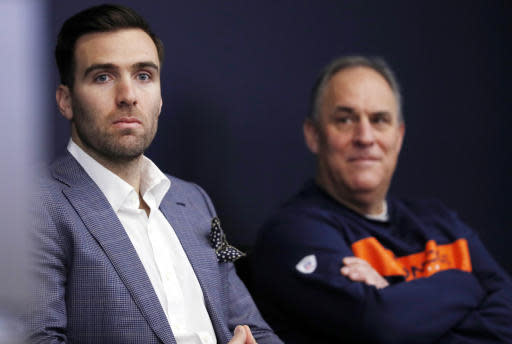 Denver Broncos new quarterback Joe Flacco, left, waits with head coach Vic Fangio to talk to reporters at a news conference at the NFL football team's headquarters Friday, March 15, 2019, in Englewood, Colo. (AP Photo/David Zalubowski)