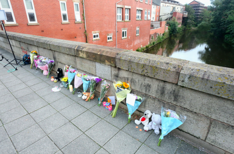 Tributes to the baby have begun lining up at the bridge (SWNS)