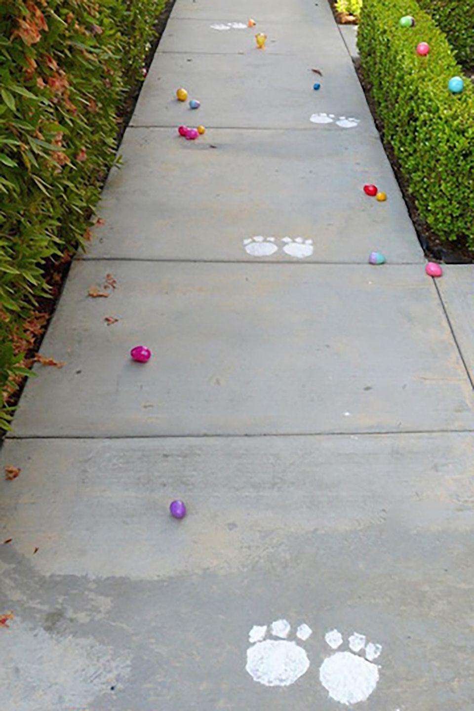 """<p>Create """"bunny tracks"""" around where you're hiding the eggs. Toddlers will be thrilled to see the Easter Bunny's paw prints!</p><p><strong>Get the tutorial at <a href=""""http://www.smartschoolhouse.com/diy-crafts/easter-bunny-trail/2"""" rel=""""nofollow noopener"""" target=""""_blank"""" data-ylk=""""slk:Smart Schoolhouse"""" class=""""link rapid-noclick-resp"""">Smart Schoolhouse</a>. </strong></p><p><strong><a class=""""link rapid-noclick-resp"""" href=""""https://www.amazon.com/Crayola-Non-Toxic-White-Colored-Bundle/dp/B0042Y450Q/ref=sr_1_1?dchild=1&keywords=chalk&qid=1614113310&sr=8-1&tag=syn-yahoo-20&ascsubtag=%5Bartid%7C10050.g.4083%5Bsrc%7Cyahoo-us"""" rel=""""nofollow noopener"""" target=""""_blank"""" data-ylk=""""slk:SHOP CHALK"""">SHOP CHALK</a><br></strong></p>"""