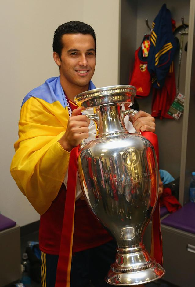 KIEV, UKRAINE - JULY 01: Pedro of Spain poses with the trophy in the dressing room following the UEFA EURO 2012 final match between Spain and Italy at the Olympic Stadium on July 1, 2012 in Kiev, Ukraine. (Photo by Handout/UEFA via Getty Images)