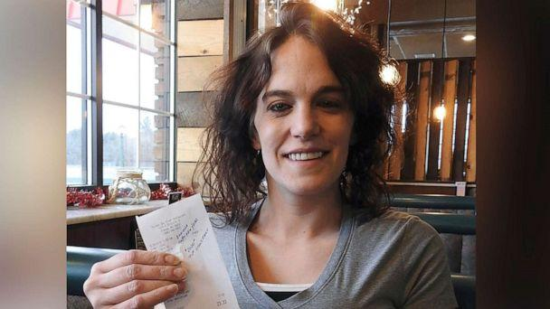 PHOTO: Server Danielle Franzoni holds a receipt from a customer with a $2,020 tip included at Thunder Bay River Restaurant in Alpena, Mich., Dec. 30, 2019. The credit card receipt said 'Happy New Year. 2020 Tip Challenge.' (Julie Riddle/The Alpena News via AP)