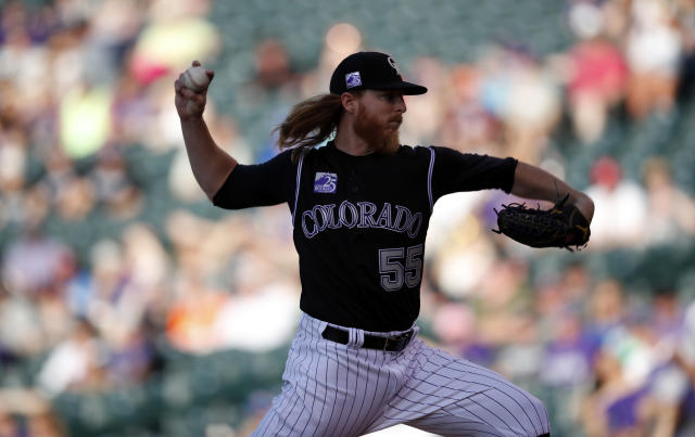Colorado Rockies starting pitcher Jon Gray delivers to Cincinnati Reds' Jesse Winker in the first inning of a baseball game Friday, May 25, 2018, in Denver. (AP Photo/David Zalubowski)