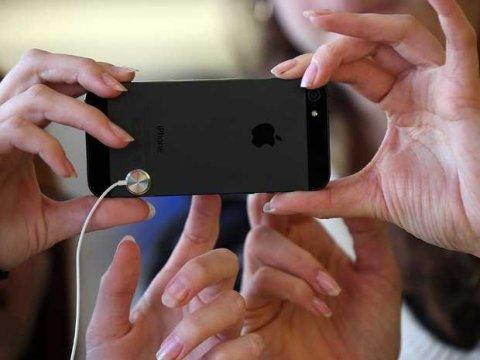iphone 5 hands Getty