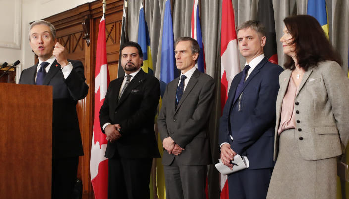 Francois-Philippe Champagne, Canada Minister of Foreign Affairs, from left, Afghanistan Minister of Foreign Affairs Idrees Zaman, British MP Andrew Murrison, Ukraine's Minister of Foreign Affairs Vadym Prystaiko and Sweden's Minister for Foreign Affairs Ann Linde listen during a press conference after a meeting of the International Coordination and Response Group for the families of the victims of PS752 flight that crashed shortly after taking off from the Iranian capital Tehran on Jan. 8, killing all 176 passengers and crew on board.(AP Photo/Frank Augstein)