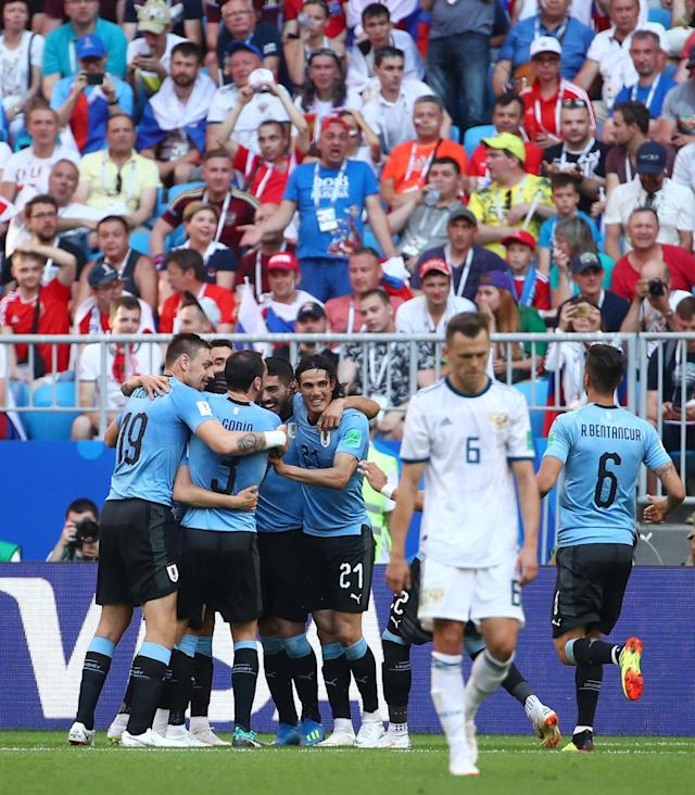 Soccer Football - World Cup - Group A - Uruguay vs Russia - Samara Arena, Samara, Russia - June 25, 2018 Uruguay's Diego Laxalt celebrates scoring their second goal with teammates REUTERS/Michael Dalder