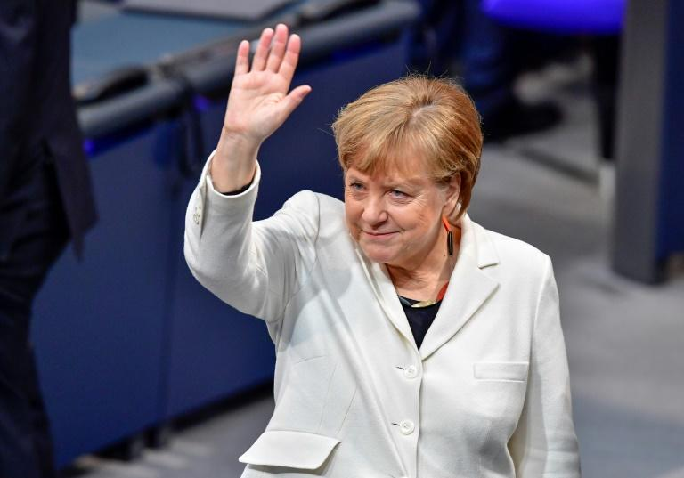 For Merkel, the ceremony marked the end of a painful stretch of post-election paralysis, the deepest crisis of her 12-year career