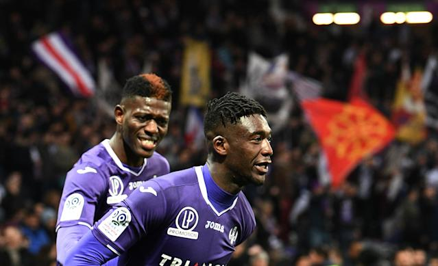 Soccer Football - Ligue 1 - Toulouse vs AS Monaco - Stadium Municipal de Toulouse, Toulouse, France - February 24, 2018 Toulouse's Yaya Sanogo celebrates scoring their third goal with Ibrahim Sangare REUTERS/Fred Lancelot
