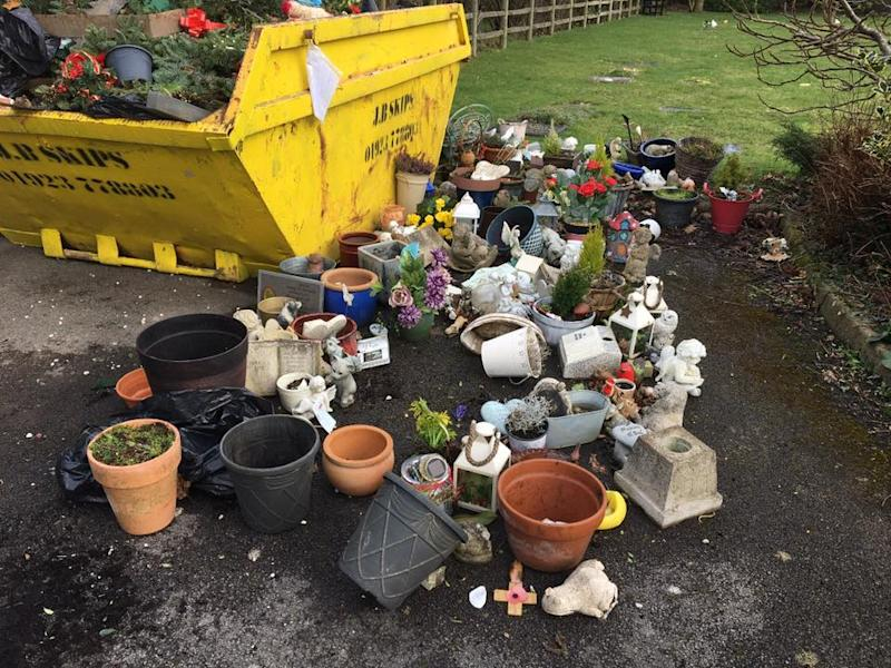 Crosses and ornaments were disposed of in a cemetary skip in Gerrards Cross, Bucks. Angry mourners say they had no warning (Ann Sibley/Facebook)