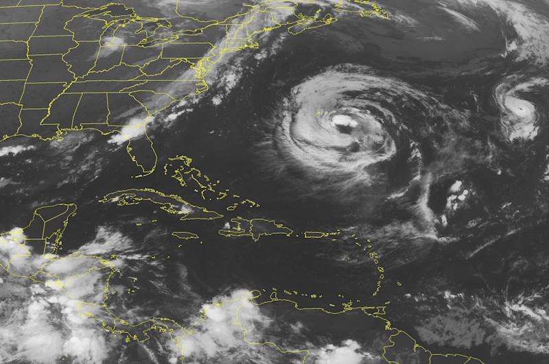 This NOAA satellite image taken Sunday, Sept. 9, 2012 at 1:45 a.m. EDT shows Tropical Storm Leslie about 180 miles southeast of Bermuda moving north at 8 mph. Max winds are currently at 65 mph and Leslie is forecast to become a hurricane by tonight.  Hurricane Michael in the central Atlantic and has max winds of 100 mph. The hurricane is moving north-northwest at 6 mph. (AP PHOTO/WEATHER UNDERGROUND)