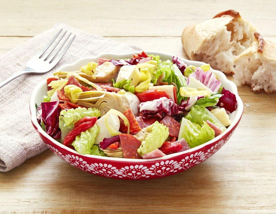 """<p>Instead of your typical cheese board appetizer, this antipasti salad is loaded with cheese, meats, and Italian flavor. </p><p><strong><a href=""""https://www.thepioneerwoman.com/food-cooking/recipes/a32676515/antipasti-chopped-salad-recipe/"""" rel=""""nofollow noopener"""" target=""""_blank"""" data-ylk=""""slk:Get the recipe."""" class=""""link rapid-noclick-resp"""">Get the recipe.</a></strong> </p>"""