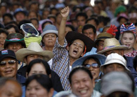 A farmer reacts as she takes part in a rally demanding the Yingluck administration resolve delays in payment, at the Commerce Ministry in Nonthaburi province, on the outskirts of Bangkok February 19, 2014. REUTERS/Chaiwat Subprasom