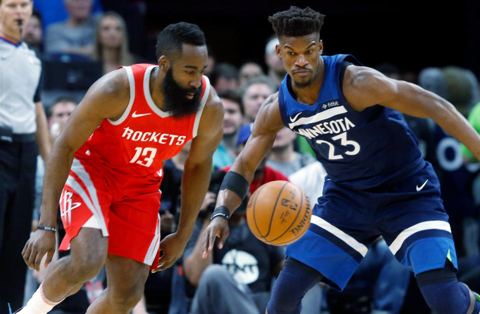 Houston Rockets' James Harden, left, and Minnesota Timberwolves' Jimmy Butler stare at the ball during the first half of Game 4 in an NBA basketball first-round playoff series Monday, April 23, 2018, in Minneapolis. (AP Photo/Jim Mone)