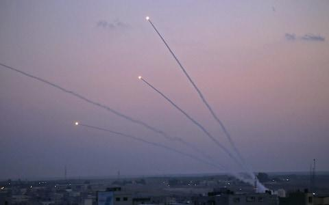 A number of rockets were launched from the Gaza Strip toward Israel following the shootout in the strip - Credit: SAID KHATIB/AFP