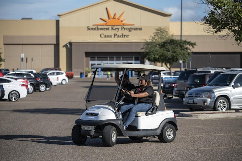 Security guards monitor the perimeter of the Southwest Key-Casa Padre Facility, formerly a Walmart store, in Brownsville, Texas, on June 17, 2018. (Bloomberg via Getty Images)