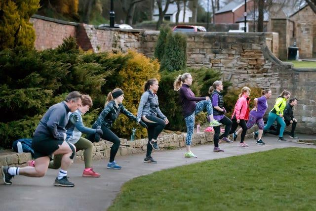 """People taking part in a """"Boot Camp"""" exercise class in Springhead Park, Rothwell, Leeds"""
