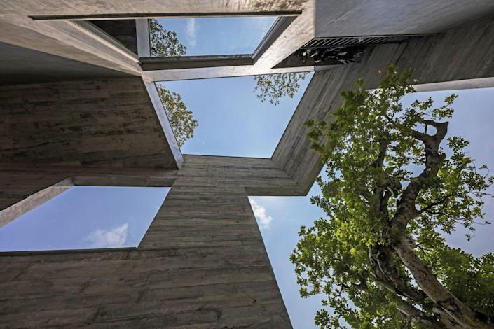 Close-ups of the Ha Long Villa's exterior facade show just how the openings and trees work in perfect conjunction with one another.