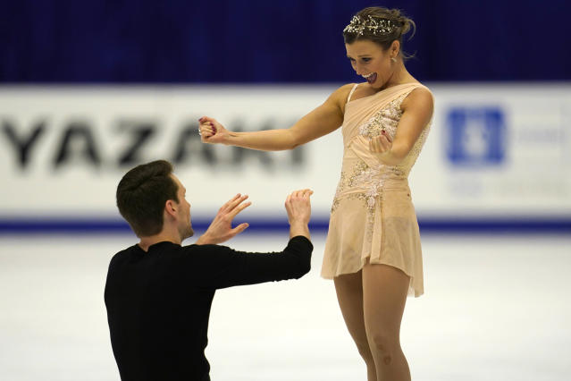 Kirsten Moore-Towers and Michael Marinaro of Canada react after performing in the pairs free skating program during the ISU Grand Prix of Figure Skating in Sapporo, northern Japan, Saturday, Nov. 23, 2019. (AP Photo/Toru Hanai)