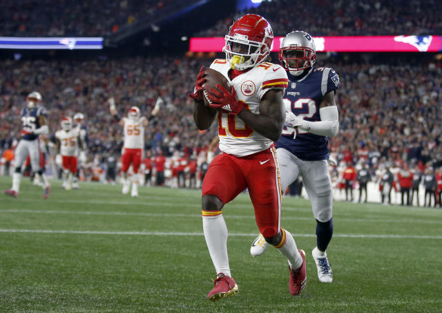 Tyreek Hill scoring one of his three touchdowns on Sunday night against the Patriots. (AP)