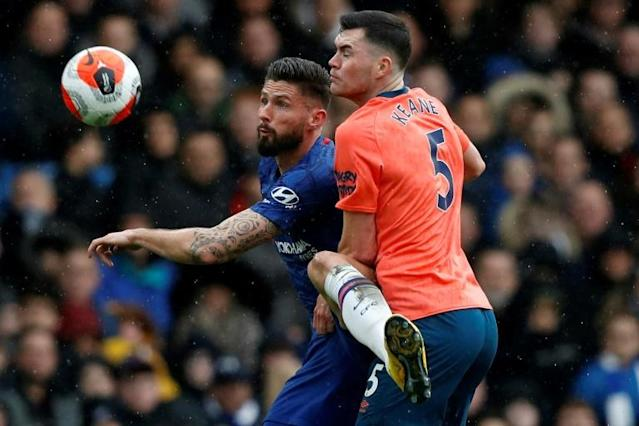 Still training: Everton defender Michael Keane (R) pictured in action against Chelsea's Olivier Giroud (L) (AFP Photo/Adrian DENNIS)