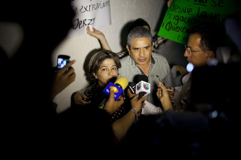 Edna Ponce, center, speaks to the reporters after meeting with chief prosecutor Rodolfo Rios, in Mexico City, Tuesday, June 4, 2013. Ponce is the aunt of Jerzy Ortiz, one of a group of men and women who went missing on May 26, 2013 from a Mexico City bar. Another young woman has been added to the list of young people apparently abducted as a group from an after-hours bar in a normally calm district of Mexico City, raising the number of missing to 12, prosecutors said Tuesday night. (AP Photo/Ivan Pierre Aguirre)