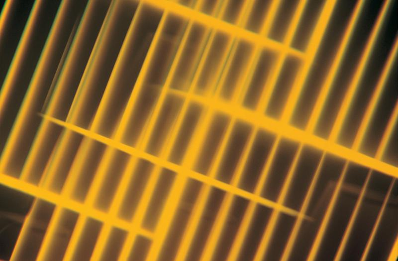 Bright yellow grid on black background