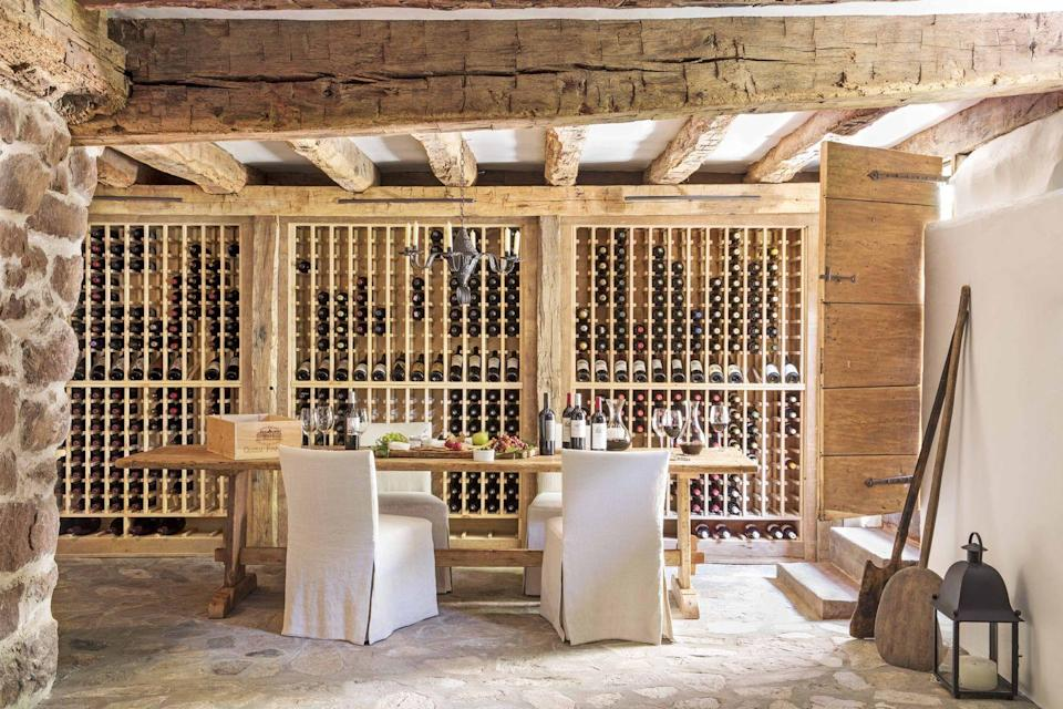 """<p>In this Connecticut wine cellar designed by Steve and Brooke Giannetti, the beams were custom made from salvaged wood. The chairs, from <a href=""""https://giannettihome.com/"""" rel=""""nofollow noopener"""" target=""""_blank"""" data-ylk=""""slk:Giannetti Home"""" class=""""link rapid-noclick-resp"""">Giannetti Home</a>, are slipcovered in a <a href=""""https://www.libeco.com/en/"""" rel=""""nofollow noopener"""" target=""""_blank"""" data-ylk=""""slk:Libeco"""" class=""""link rapid-noclick-resp"""">Libeco</a> linen.</p>"""