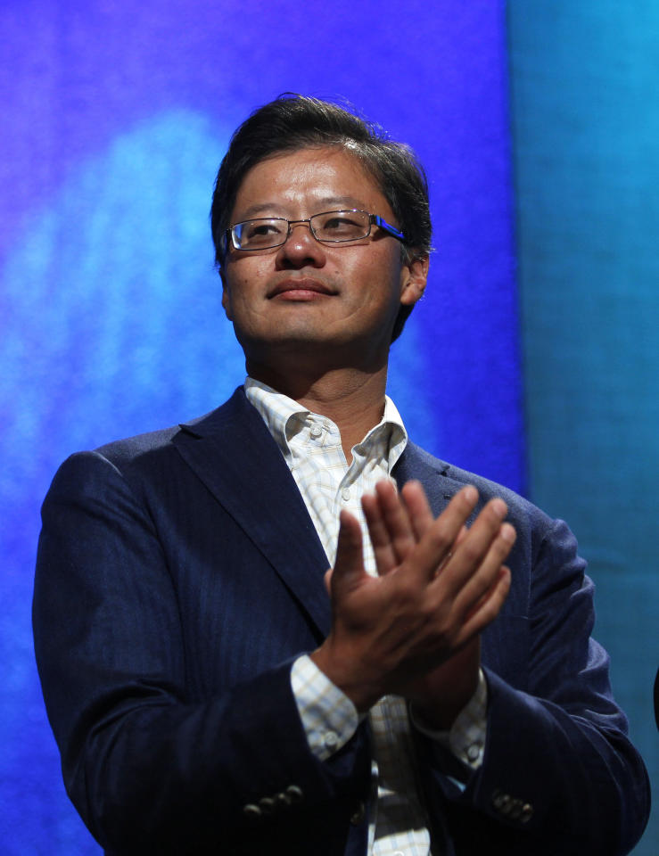 Co-founder and former CEO of Yahoo! Inc. Jerry Yang applauds during the announcement of a commitment pledge at the Clinton Gala Awards
