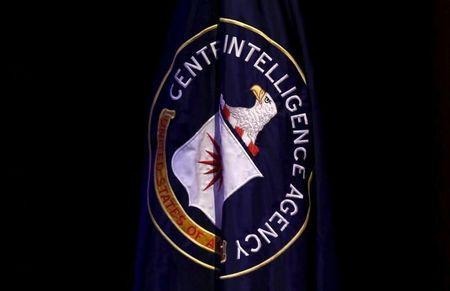 """The Central Intelligence Agency (CIA) flag is displayed on stage during a conference on national security entitled """"The Ethos and Profession of Intelligence"""" in Washington October 27, 2015. REUTERS/Yuri Gripas"""