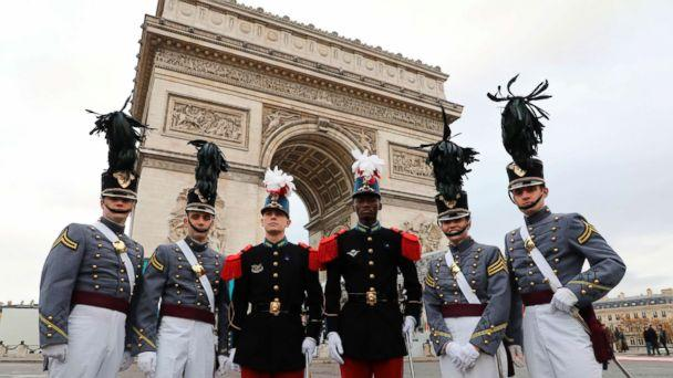 PHOTO: Saint-Cyr cadets, center, pose with West Point cadets ahead of a ceremony at the Arc de Triomphe in Paris, as part of commemorations marking the 100th anniversary of the Nov. 11, 1918, armistice, ending World War I, Nov. 11, 2018. (Ludovic Marin/Pool Photo via AP)