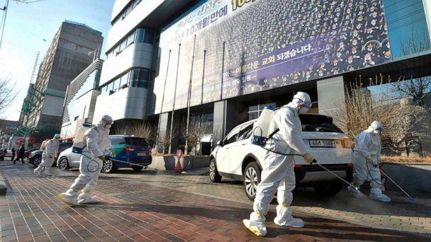 PHOTO: This picture taken on February 19, 2020 shows South Korean health officials spray disinfectant near Shincheonji Church of Jesus in the southeastern city of Daegu on Feb. 19, 2020, after a number of churchgoers were identified as having COVID-19. (YONHAP/AFP via Getty Images)